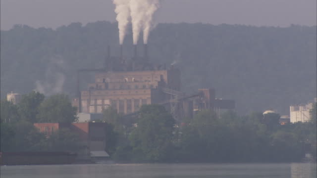 WS Coal-fired Power Plant seen across calm lake / Pittsburgh area, Pennsylvania, USA