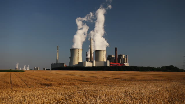 WS Coal-powered power station, field in foreground, near Cologne, North-Rhine-Westphalia, Germany