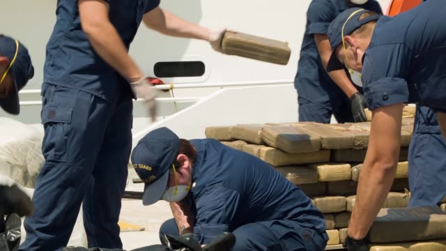 S Coast Guard crew members off loading marijuana from the Paul Clark one of the Coast Guard's newest fastresponse cutters on May 9 2014 in Miami...