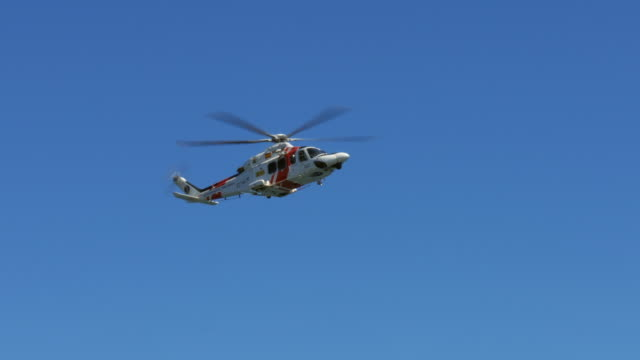 Coast guard rescue helicopter flying on the sky