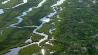 Coastal streams snake through grassy wetlands along the Gulf Islands National Seashore in Mississippi.