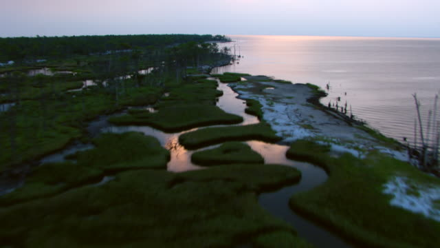 Coastal waters stream through grassy marshes along the Gulf Islands National Seashore in Mississippi.