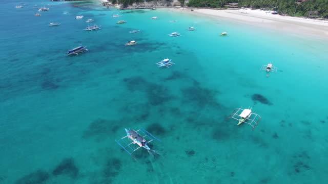 Coastline aerial view of boats on Boracay Island.