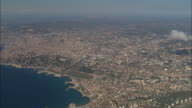 AERIAL PAN Coastline and city to Les Calanques/ Marseilles, France