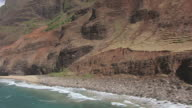AERIAL Coastline of rocky cliffs and beaches / Hawaii, United States