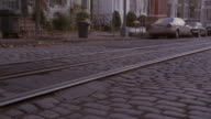 TU Cobbled stoned street and streetcar tracks in front of Georgetown University buildings / Washington, D.C., United States
