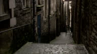Cobblestone steps lead through a narrow alleyway, Edinburgh Available in HD.