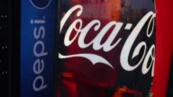 A Coca Cola Co soda machine stands in a shopping center parking lot in Jasper Indiana US on Friday April 17 2015 Shots Close up shots of a Coca Cola...