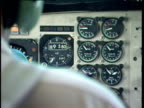 Cockpit altimeter dial increases as pilot flies aeroplane