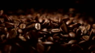 Coffee beans falling commercial in super slow motion