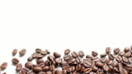 Coffee Beans on white table background with white space , dolly shot left to right
