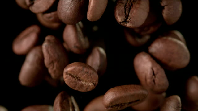 Coffee Beans Over Black Background (Super Slow Motion)