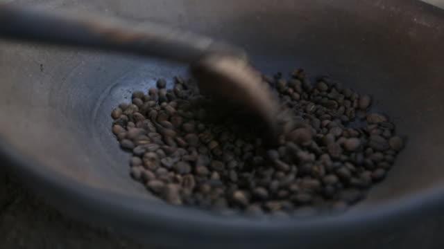 CU Coffee beans roasting on open fire