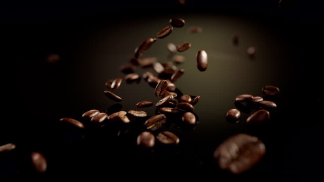 HD: Coffee beans slow motion falling
