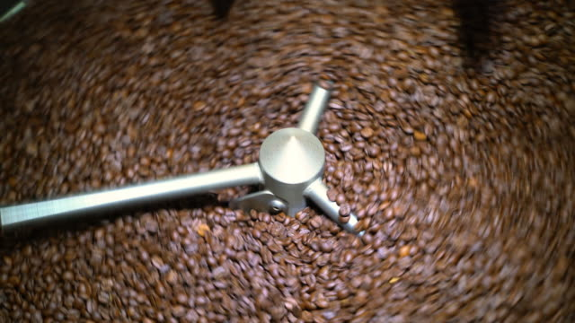 Coffee beans spinning in a cooling drum