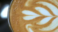 Coffee concept , Close-up panning on top view of a coffee cup latte art , 4k(UHD)