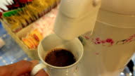 Coffee cup filled to the brim. Coffee maker fills cup of coffee