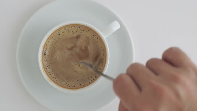 Coffee in cup is rotation.