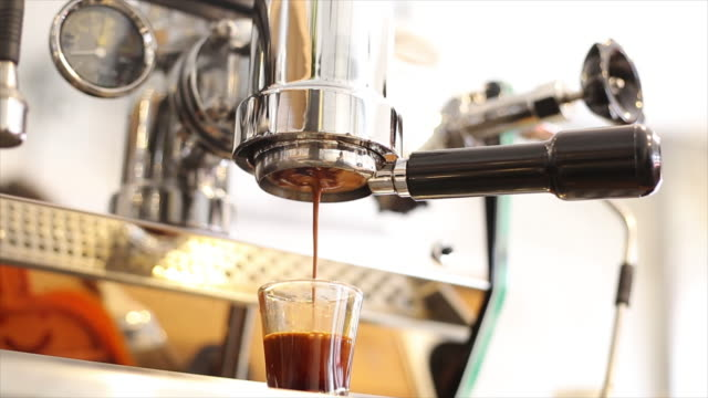 Coffee machine pouring into cup