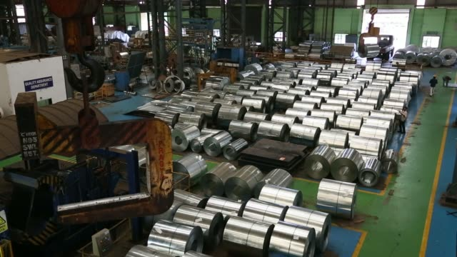 A coil of galvanized steel is transported to a packaging section at the manufacturing facility of Uttam Galva Steels Ltd the Indian unit of...
