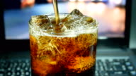 cola in drinking glass close up 4k