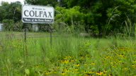 Colfax Louisana small town famous for Louisana Pecan Festival welcome sign