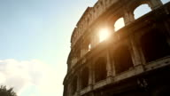 Coliseum of Rome, or Colosseo, with sun flares