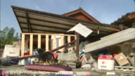 Collapsed house and its debris after consecutive earthquake attacks in Kumamoto city captured in the morning after a night of earthquakes on 15th...