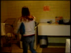/ college girl doing laundry gets a surprise when she open's dryer and there's another girl inside College girl in dryer prank on April 26 2010 in...