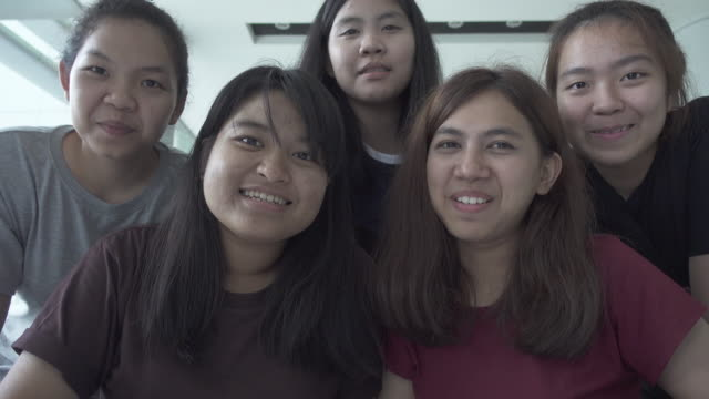 College girls talking to webcam