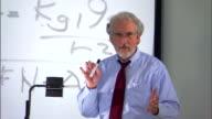 College professor lecturing in classroom
