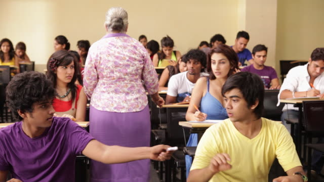 College student cheating in a exam