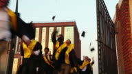 College students celebrating graduation day in the college