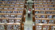 College students study in the Kyung Hee University Central Library on the university's campus in Seoul South Korea on Tuesday Sept 3 High angle view...