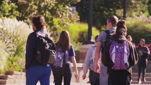 College students walk on campus.