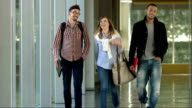 LS College Students Walking In The Corridor