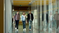 SLO MO DS College Students Walking In The Corridor