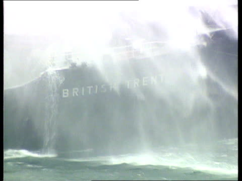 Collision between 'British Trent' and 'Western Winner' OFF 'British Trent' oil tanker Water spray falling over hull Salvage / safety experts climbing...