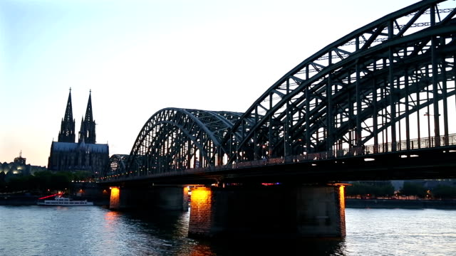 Cologne Cathedral and Hohenzollern Bridge at dusk Germany