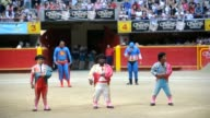 Colombian dwarf actors and clowns perform in a bullfight show at La Macarena bullring in Medellin Antioquia department Colombia on February 19 2012...