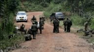 Colombian soldiers recover the bodies of some of the ten soldiers allegedly killed by FARC guerrillas