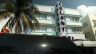 WS Colony Hotel on Ocean Drive Johnny Rockets restaurant left palm tree car driving by FG