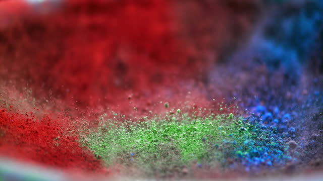 SLO MO color pigments vibrating into the air