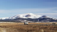 Colorado landscape with road and truck