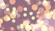 Farbige Partikeln floating in Zeitlupe. Endlos wiederholbar FullHD video an