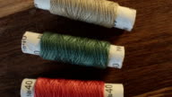 Colored sewing threads on the table