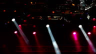 Colored spotlights on the stage.