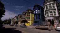 Colorful homes line a residential street in San Francisco. Available in HD.