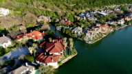 Colorful Million Dollar Mansions line the riverbank of West Lake in Austin , Texas , USA