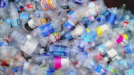 CU HA Colorful plastic bottles falling onto heap to be recycled, Santa Barbara, California, USA